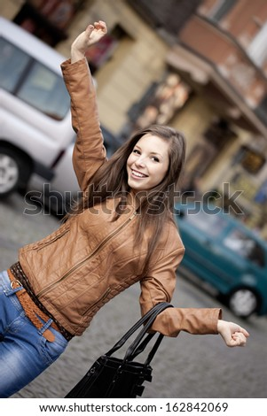 Young woman portrait on the street - stock photo