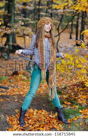 young woman portrait outdoor in autumn - stock photo