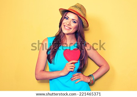 Young woman portrait. red Heart. Love symbol. - stock photo