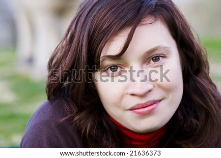 Young woman portrait smiling at camera - stock photo
