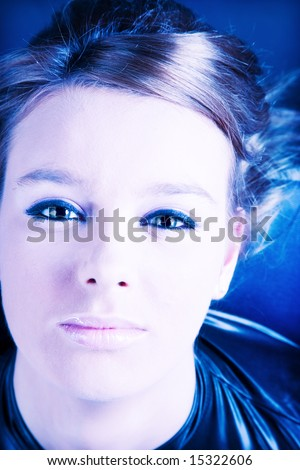 Young woman portrait. Soft blue and pink colors. - stock photo