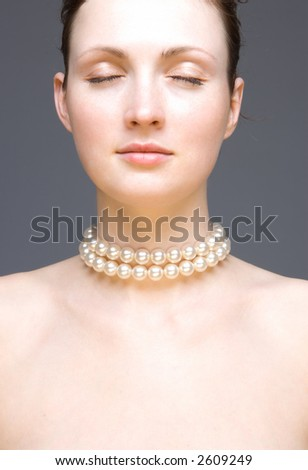 Young woman portrait - studio shot isolated on the gray - stock photo