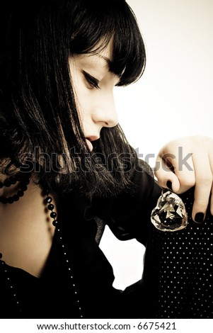 young woman portrait with a hart of glass in hand - stock photo