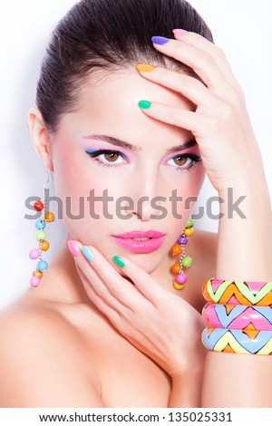 young woman portrait with colorful makeup and nail polish, studio shot - stock photo