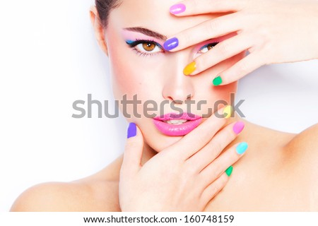 young woman portrait with colorful makeup and nail polish, studio white - stock photo