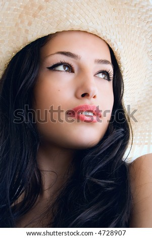 young woman portrait with hat, studio - stock photo
