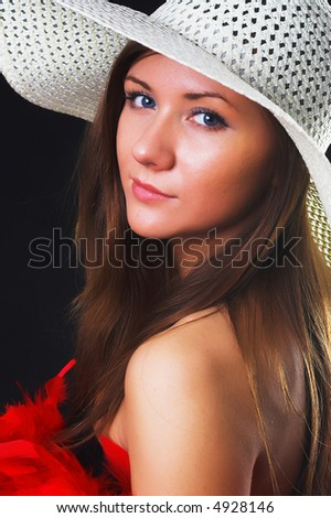 young woman portrait with hat, studio