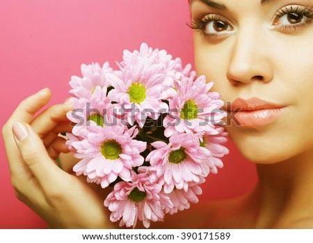 Young woman portrait with pink chrysanthemum - stock photo