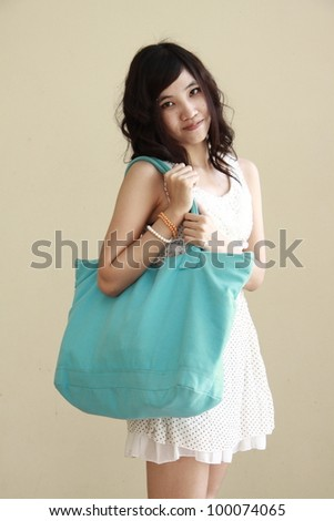 young woman portrait with shopping bag