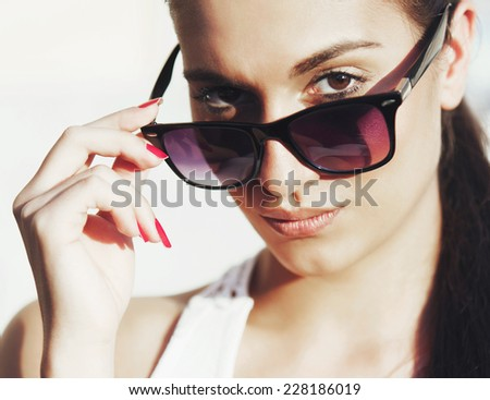 Young woman portrait with sun glasses and pony tail - stock photo