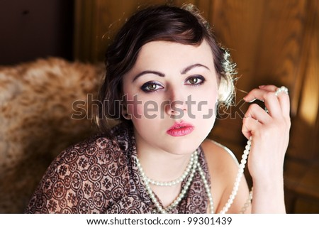 Young woman posing in a studio. Focus on face. - stock photo