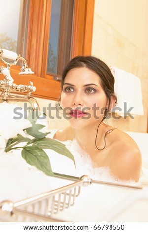 Young woman posing in bubble bath - stock photo