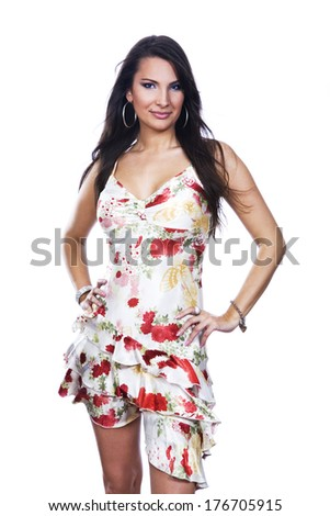 Young woman posing in floral dress isolated on white background
