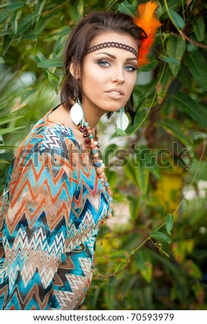 Young woman posing in the forest - stock photo