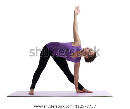 young woman posing in yoga asana on rubber mat - stock photo