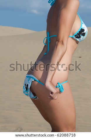young woman posing near the beach - stock photo