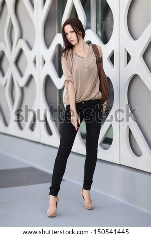 Young Woman posing near the modern building - stock photo