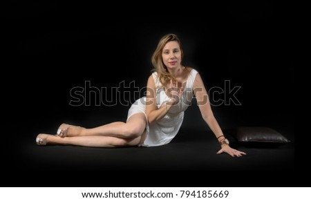 young woman posing on floor