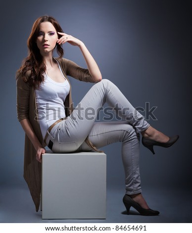Young woman Posing on gray background - stock photo