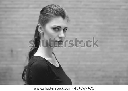 Young woman posing outdoor. Street fashion. Black and white image.