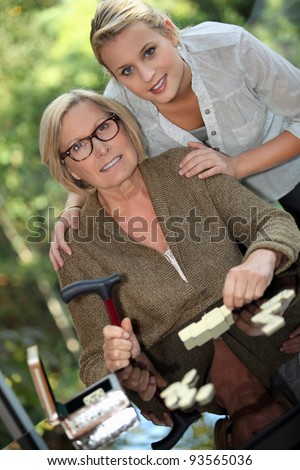 Young woman posing with her grandmother - stock photo