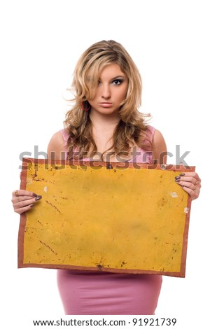 Young woman posing with yellow vintage board - stock photo