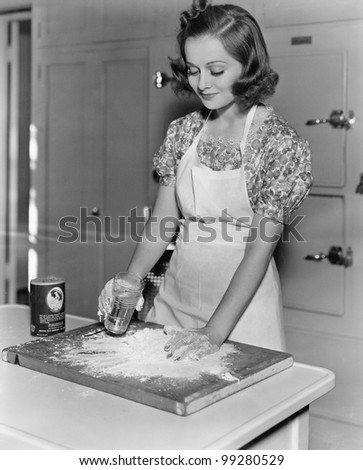 Young woman pouring water into flour