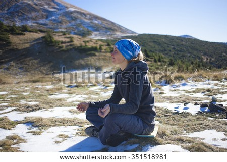 Young woman practices yoga in nature.