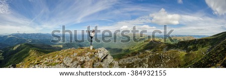 Young woman practices yoga on a mountain top, Carpathian mountains - stock photo