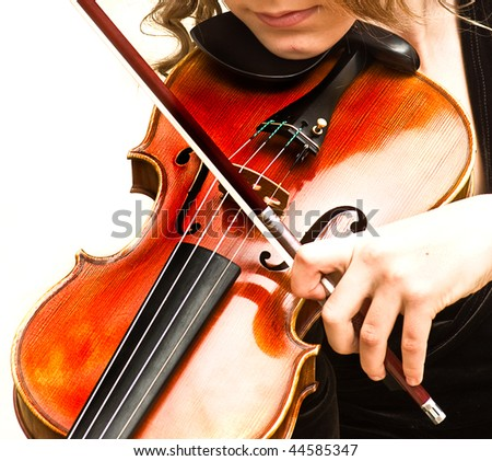 young woman practicing her violin - stock photo