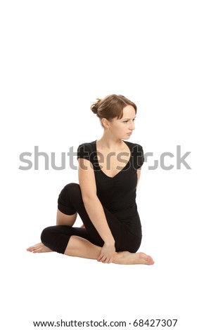 Young woman practicing Yoga exercises.
