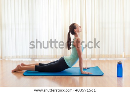 Young woman practicing yoga in studio.  - stock photo