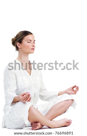 Young woman practicing yoga in the lotus position - stock photo