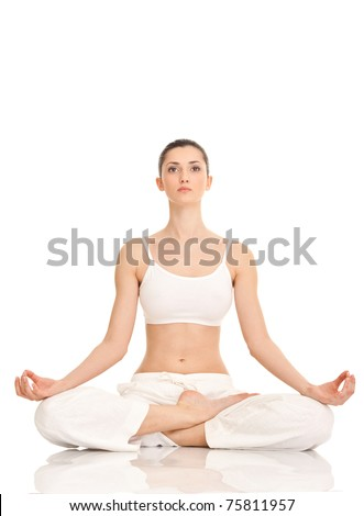 young woman practicing yoga in the lotus position, isolated on white