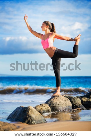 Young woman practicing yoga on the beach at sunset, Wellness Concept Healthy Lifestyle - stock photo