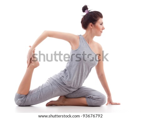 young woman practises yoga isolated on white background