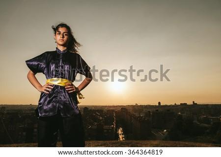 Young Woman Practising Martial Arts - stock photo