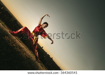 Young Woman Practising Wushu at Sunset