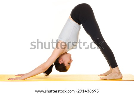 young woman practising yoga exercises on yellow mat isolated on white background