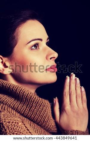 Young woman praying. - stock photo
