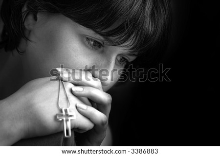 Young woman praying and meditating - stock photo