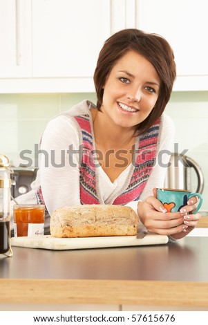 Young Woman Preparing Breakfast In Modern Kitchen - stock photo