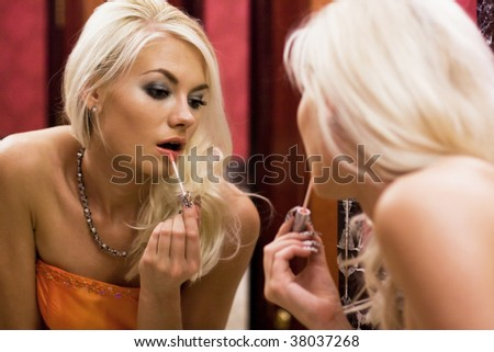 Young woman preparing for a party - stock photo