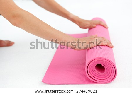 Young woman preparing for yoga class. - stock photo