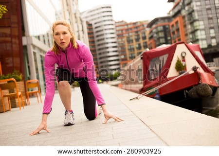 young woman preparing to run - stock photo