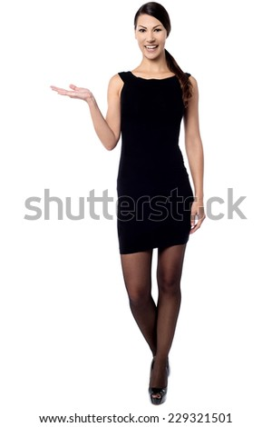 Young woman presenting copy space on her palm - stock photo