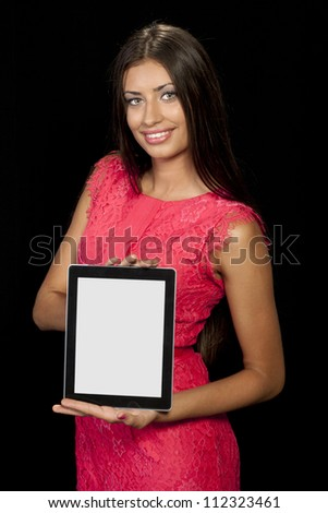 Young woman presenting digital tablet - stock photo