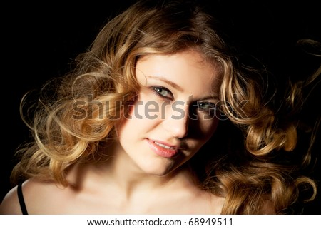 young woman presents her golden locks - stock photo