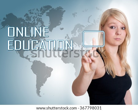 Young woman press digital Online Education button on interface in front of her - stock photo