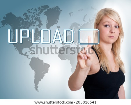 Young woman press digital Upload button on interface in front of her - stock photo